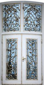 Дверь стальная полукруглая с ковкой и стеклопакетами